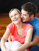 Couple sitting on the floor of their new apartment — Stock Photo