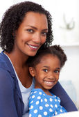 Smiling mother and her little girl — Stock Photo