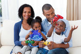 Happy Afro-american family playing video games — Stock Photo
