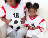 Mother and her daughter watching a football match — Stock Photo