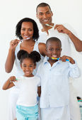 Smiling family brushing their teeth — Stock Photo