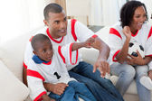 Excited Afro-American family wathing a football match — Stock Photo