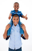 Father giving son piggyback ride with thumbs up — Stock Photo