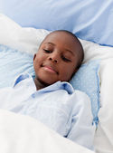 Little boy sick in bed — Stock Photo