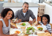 Ethnic couple dining with their son — Stock Photo