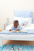 Little boy reading a book — Stock Photo