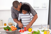 Loving father helping his son cut vegetables — Stock Photo
