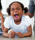 Angry little girl shouting — Stock Photo