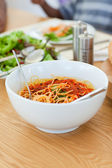 Pasta in a bowl on the table — Stock Photo