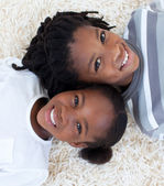 Portrait of Afro-American brother and sister on floor — Stock Photo