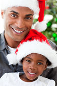 Portrait of a smiling father and daughter at Christmas time — Stock Photo