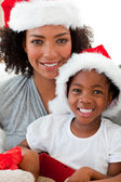 Portrait of a mother and a daughter wearing a Christmas hat — Stock Photo
