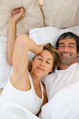 Beautiful couple waking up — Stock Photo
