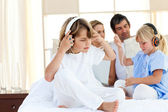 Jolly siblings listening music with headphones — Stockfoto