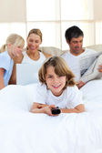 Enthusiastic little boy holding a remote — Stock Photo