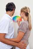 Happy Couple choosing a color with to paint their bedroom — Stock Photo