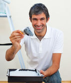 Attractive man painting a wall — Stock Photo