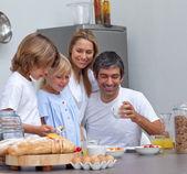 Joyful family having breakfast — Stock Photo
