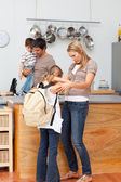 Family in the kitchen before going to school — Stock Photo