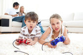 Lively children playing video games — Stock Photo