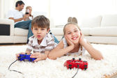 Adorable siblings playing video games — Stock Photo