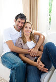 Happy couple relaxing on the sofa — Stock Photo