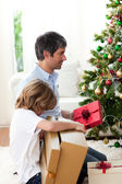 Father and his son opening Christmas gifts — Stock Photo