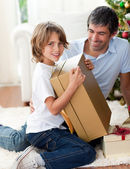 Happy Father and his son opening Christmas gifts — Stock Photo