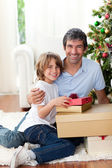 Father and his son holding Christmas gifts — Stock Photo