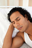 Attractive man sleeping on the bed — Stock Photo