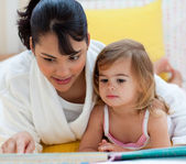Little girl and her mother reading — Stock Photo