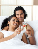 Happy young couple toasting with Champagne — Stock Photo