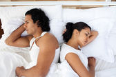 Upset couple in bed sleeping separately — Stock Photo