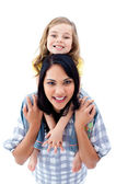 Happy mother giving her little girl piggyback ride — Stock Photo