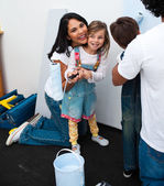 Portrait of little girl painting with her mother — Stock Photo