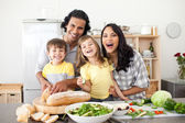 Lively family having fun in the kitchen — Stock Photo
