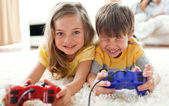 Brother and sister playing video game — Stock Photo
