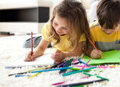 Close-up of children drawing lying on the floor — Stock Photo