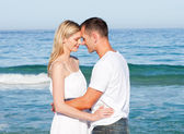Intimate lovers embracing at the beach — Stock Photo