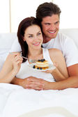 Joyful couple having breakfast — Stock Photo