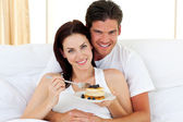 Jolly couple having breakfast — Stock Photo