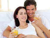 Romantic couple drinking orange juice — Stock Photo