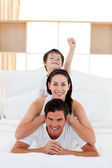 Cute little boy and his parents having fun — Stock Photo