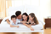 Siblings with their parents having fun — Stock Photo