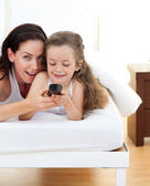 Attractive mother and her daughter having fun — Stock Photo