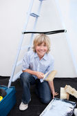Portrait of little boy renovating home — Stock Photo