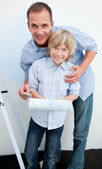 Happy father and his son renovating home — Stock Photo