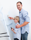 Father and his son painting a room — Stock Photo