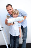 Portrait of a father and his boy renovating home — Stock Photo