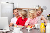 Lively family having breakfast together — Stock Photo